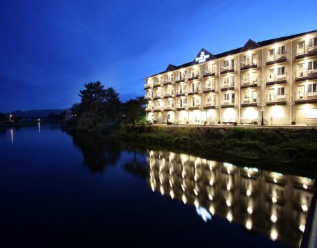 River Inn Hotel in Seaside, Oregon - Necanicum River and River Inn at Night