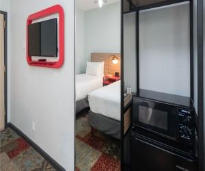 Minna Hotel SF - Wall Mounted Television